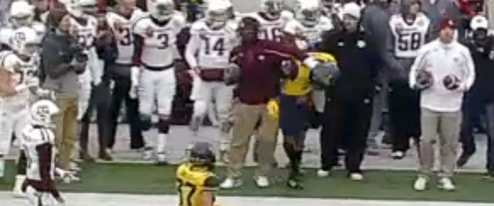 Watch Texas A&M Assistant Shove Opposing Players on the