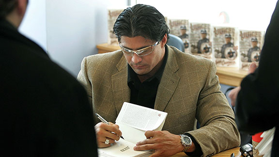 Former MLB player Jose Canseco signs copies of his best-seller book Juiced March 18, 2005 at Borders Books in Chicago, Illinois. Cansecos controversial book references the use of anabolic steroids in Major League Baseball. Death threats to Canseco made