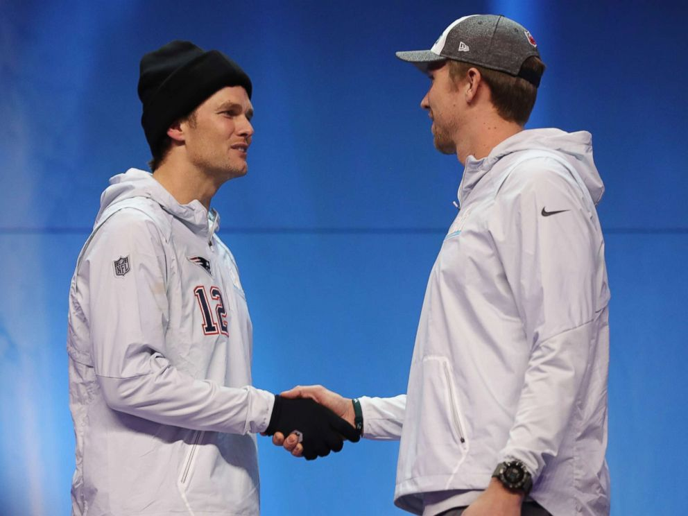 PHOTO: Tom Brady #12 of the New England Patriots and Nick Foles #9 of the Philadelphia Eagles shake hands during Super Bowl Media Day at Xcel Energy Center, Jan. 29, 2018, in St Paul, Minn.