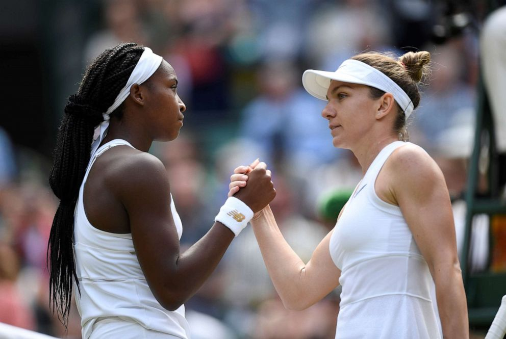 PHOTO: Cori Gauff of the U.S. congratulates Romanias Simona Halep, right, after their fourth round match at Wimbledon, July 8, 2019, in London.