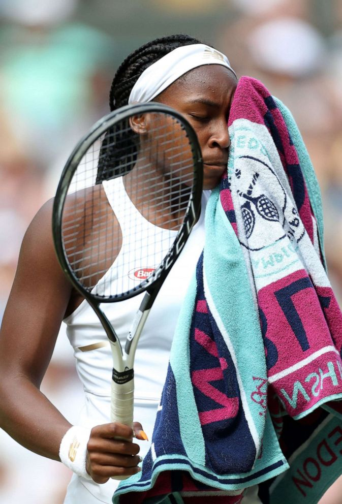 PHOTO: Cori Gauff wipes her face following her defeat in her Ladies Singles fourth round match at Wimbledon to Romanias Simona Halep, in London, July 8, 2019.