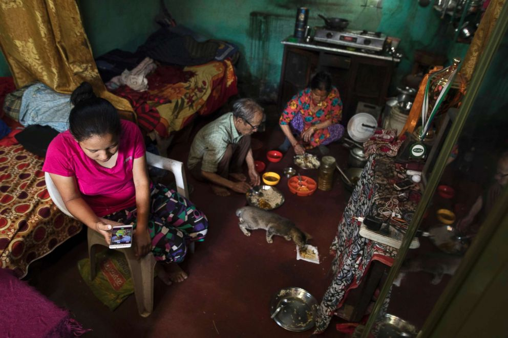 PHOTO: Pratima and her parents reside in a maintenance shed on the Royal Nepal Golf Club.