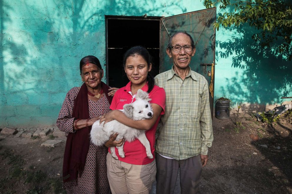 PHOTO: Pratima hopes that her golf career will make her parents proud. She poses with her father Pasang Sherpa and her mother Keshav Kumari Ghimire, and their puppy Kiki.