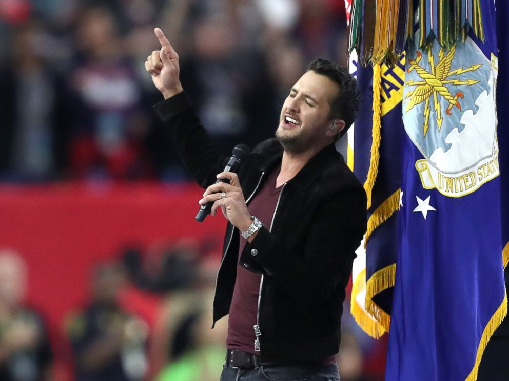 PHOTO: Luke Bryan sings the National Anthem prior to Super Bowl 51 between the New England Patriots and the Atlanta Falcons at NRG Stadium on Feb. 5, 2017 in Houston, Texas.