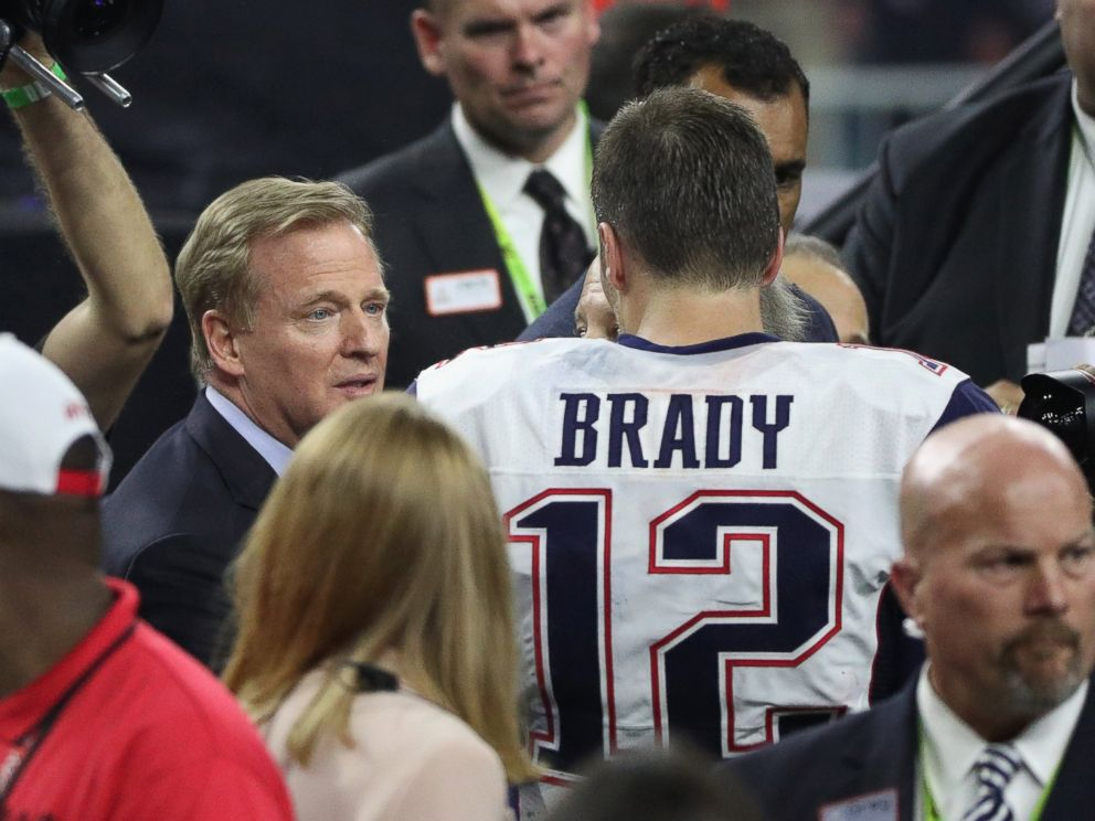 PHOTO: NFL commissioner Roger Goodell speaks to Tom Brady of the New England Patriots after defeating the Atlanta Falcons during Super Bowl 51 at NRG Stadium in Houston, Feb. 5, 2017.