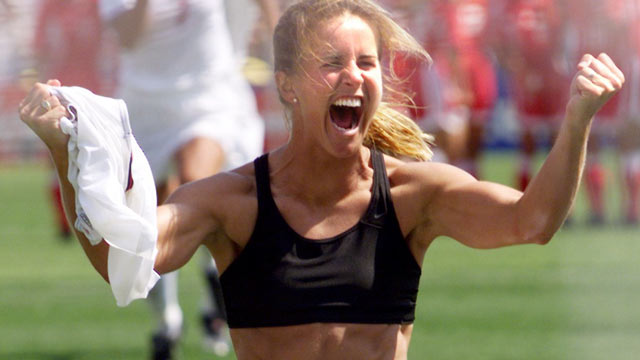 PHOTO: Brandi Chastain of the US shouts after falling on her knees after she scored the last goal in a shoot-out in the finals of the Women's World Cup with China at the Rose Bowl in Pasadena, California 10 July 1999.