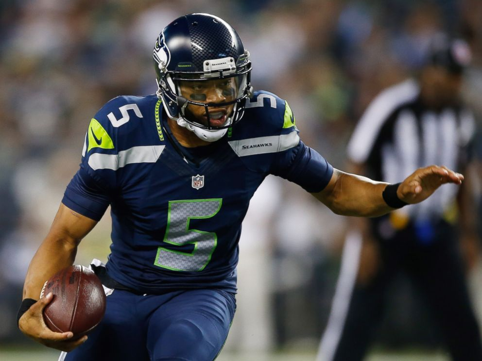 PHOTO: Quarterback B.J. Daniels #5 of the Seattle Seahawks rushes against the San Diego Chargers on Aug. 15, 2014 in Seattle.