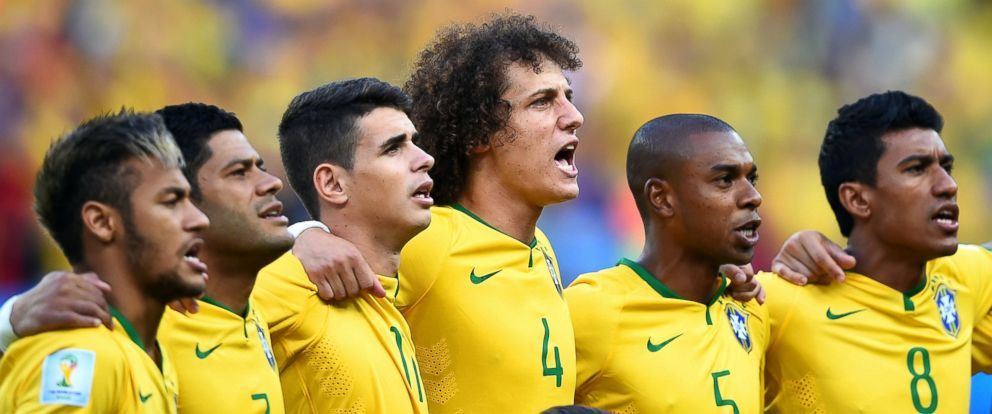 PHOTO: Neymar, Hulk, Oscar, David Luiz, Fernandinho and Paulinho of Brazil sing the National Anthem prior to the 2014 FIFA World Cup Brazil match between Brazil and Colombia at Castelao on July 4, 2014 in Fortaleza, Brazil.