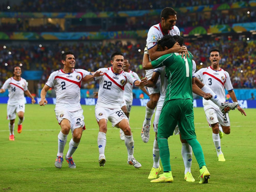 PHOTO: Keylor Navas of Costa Rica is swarmed by teammates in celebration after defeating Greece during the 2014 FIFA World Cup Brazil match at Arena Pernambuco on June 29, 2014 in Recife, Brazil.