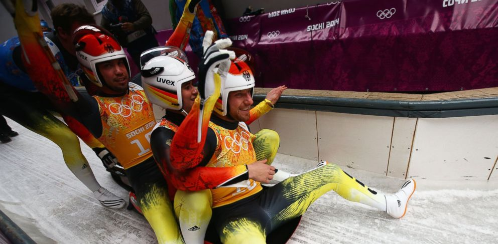 PHOTO: Tobias Wendl, Natalie Geisenberger and Tobias Arlt of Germany react after a run during the Luge Relay of the Sochi 2014 Winter Olympics at Sliding Center Sanki on Feb.13, 2014 in Sochi, Russia.