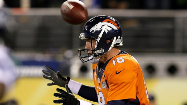 PHOTO: The ball flies over the head of quarterback Peyton Manning #18 of the Denver Broncos in the first quarter against the Seattle Seahawks during Super Bowl XLVIII at MetLife Stadium on Feb. 2, 2014 in East Rutherford, New Jersey.