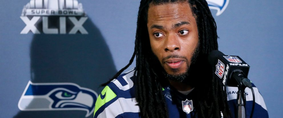 PHOTO: Seattle Seahawks Richard Sherman answers a question at a news conference for the forthcoming Super Bowl XLIX game, Jan. 28, 2015, in Phoenix, Ariz.