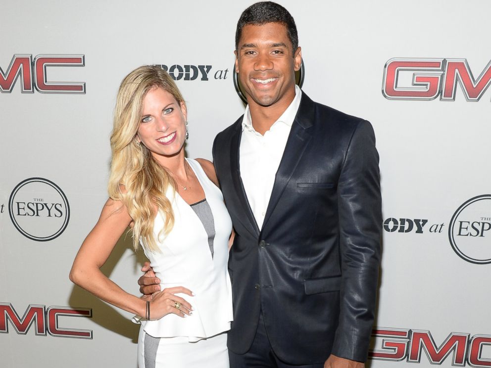 PHOTO: Seattle Seahawks quarterback Russell Wilson and Ashton Meem on July 16, 2013 in Hollywood, Calif.