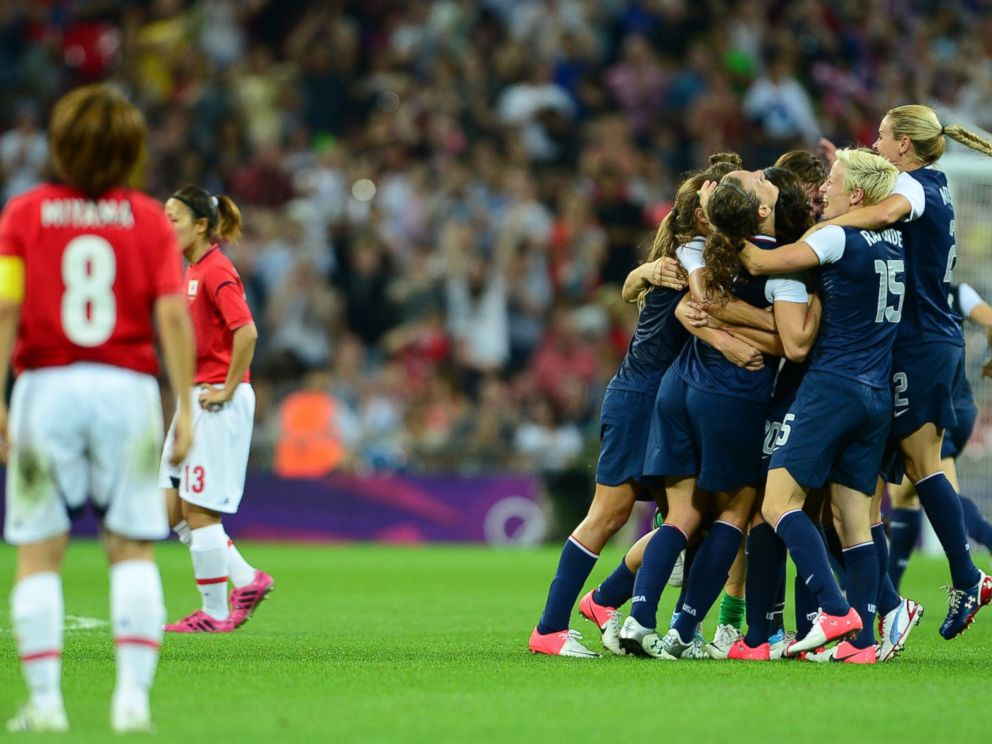 PHOTO: U.S. players celebrate winning gold against Japan during the final of the womens football competition of the London 2012 Olympic Games USA vs Japan, August 9, 2012, at Wembley stadium in London.