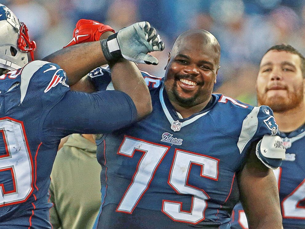 PHOTO: Vince Wilfork smiles as he leaves the game at the end of the fourth quarter after the New England Patriots played the Detroit Lions in Foxborough, Mass. on Nov. 23, 2014.