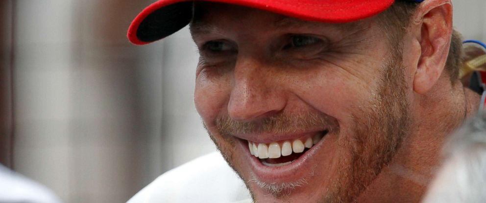 PHOTO: Philadelphia Phillies starting pitcher Roy Halladay smiles while sitting in the dugout before their game against the Chicago Cubs in Philadelphia, P.A., June 11, 2011.