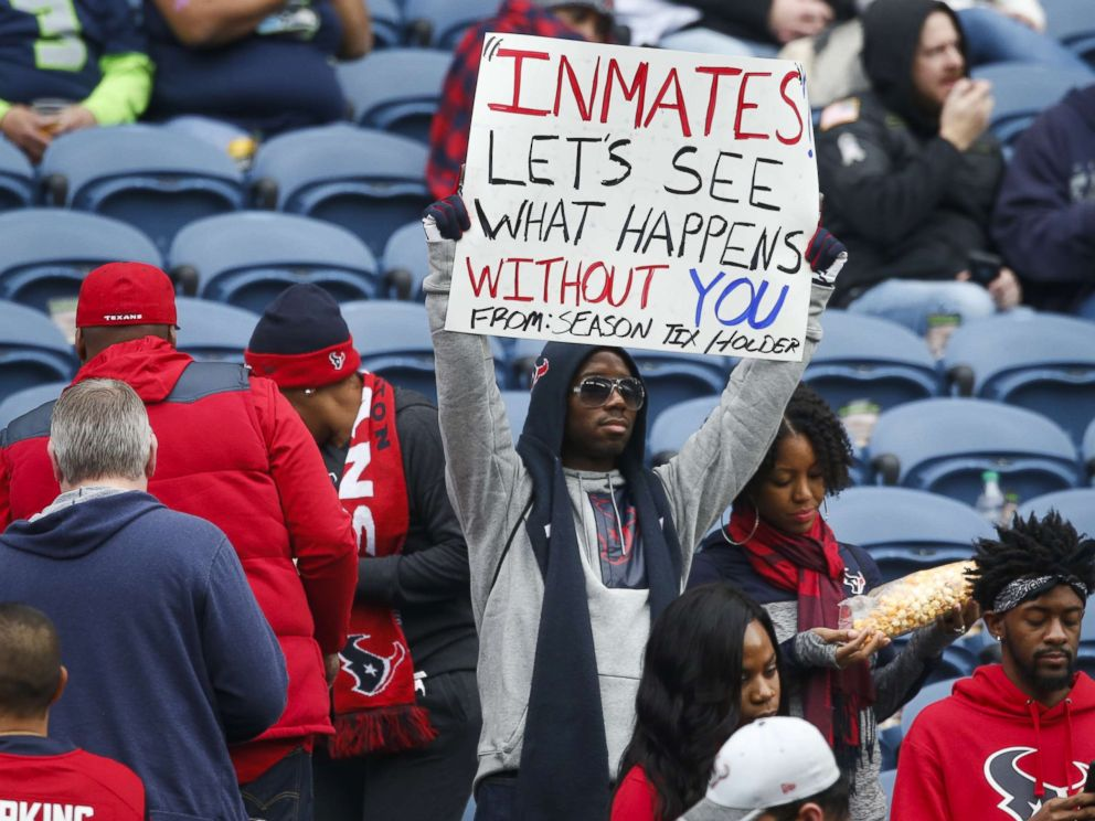 PHOTO: A Houston Texans fan holds a sign referring to Houston Texans owner Bob McNairs inmates comments before a game between the Houston Texans and Seattle Seahawks at CenturyLink Field on Oct. 29, 2017 in Seattle.