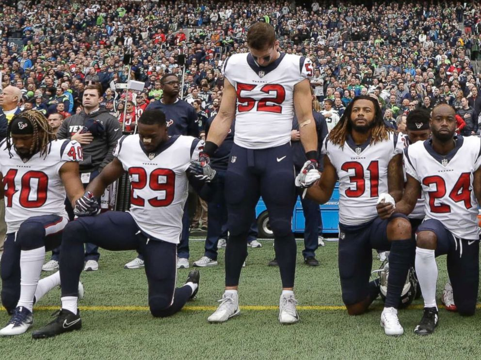 PHOTO: Houston Texans players kneel and stand during the singing of the national anthem before an NFL football game against the Seattle Seahawks, Oct. 29, 2017, in Seattle.