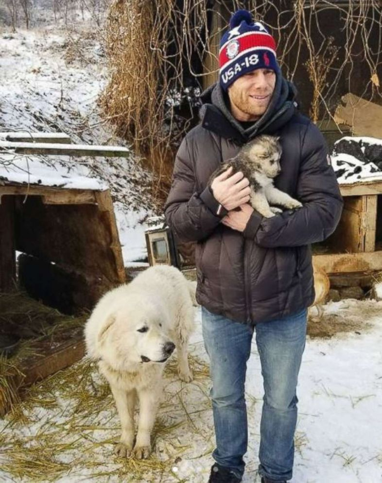 PHOTO: US Olympian Gus Kenworthys boyfriend, actor Matt Wilkas, holds a dog that the couple is rescuing from a South Korean dog meat farm. Kenworthy posted the photo on Instagram on Feb. 23, 2018.