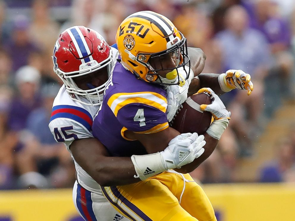 PHOTO: LSU running back Nick Brossette (4) is tackled by Louisiana Tech defensive end Jaylon Ferguson (45) in the first half of an NCAA college football game in Baton Rouge, LA., Saturday, Sept. 22, 2018.