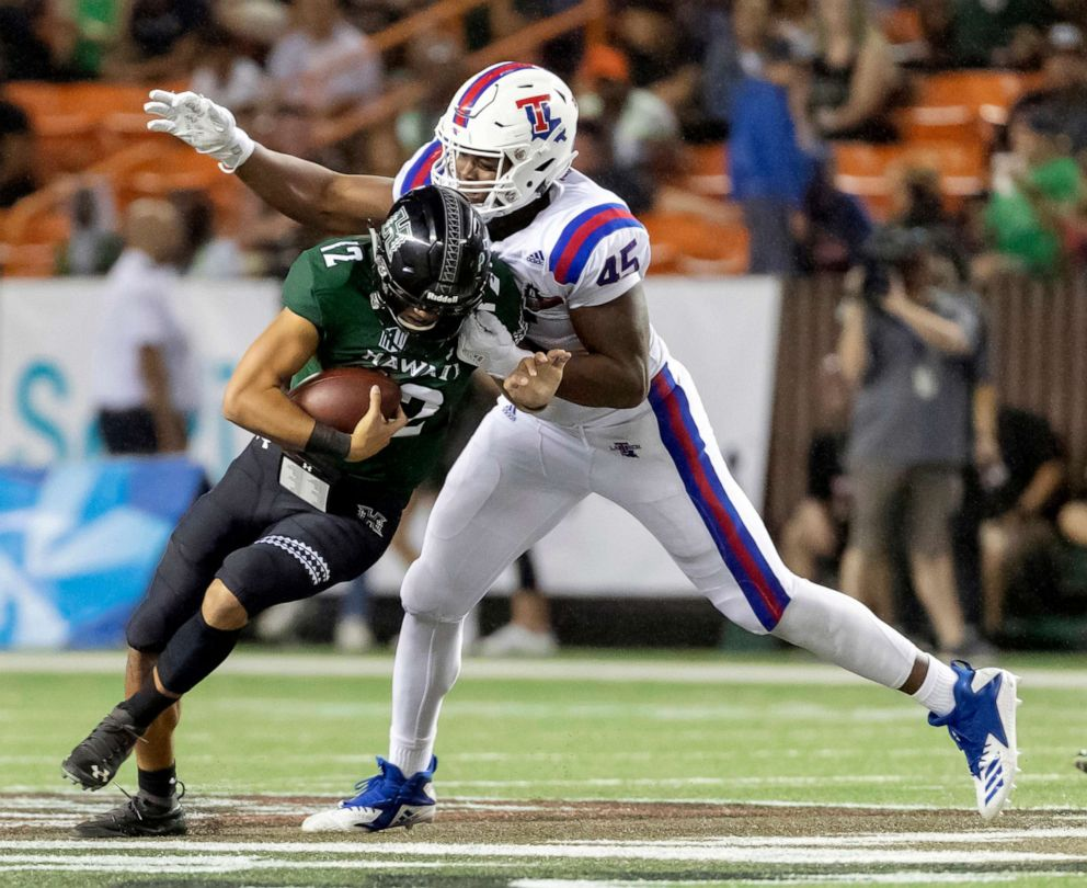 PHOTO: In this Dec. 22, 2018, file photo, Louisiana Tech defensive end Jaylon Ferguson sacks Hawaii quarterback Chevan Cordeiro in the first half of the Hawaii Bowl NCAA college football game, in Honolulu.