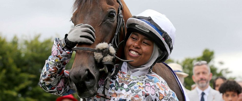 PHOTO: British Jockey Khadijah Mellah cuddles Haverland after winning the all-female Magnolia Cup, an amateur jockeys charity race, on Thursday, Aug. 1, 2019.