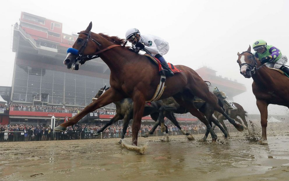 PHOTO: Justify, with Mike Smith aboard, wins the 143rd Preakness Stakes horse race at Pimlico race course in Baltimore, May 19, 2018.