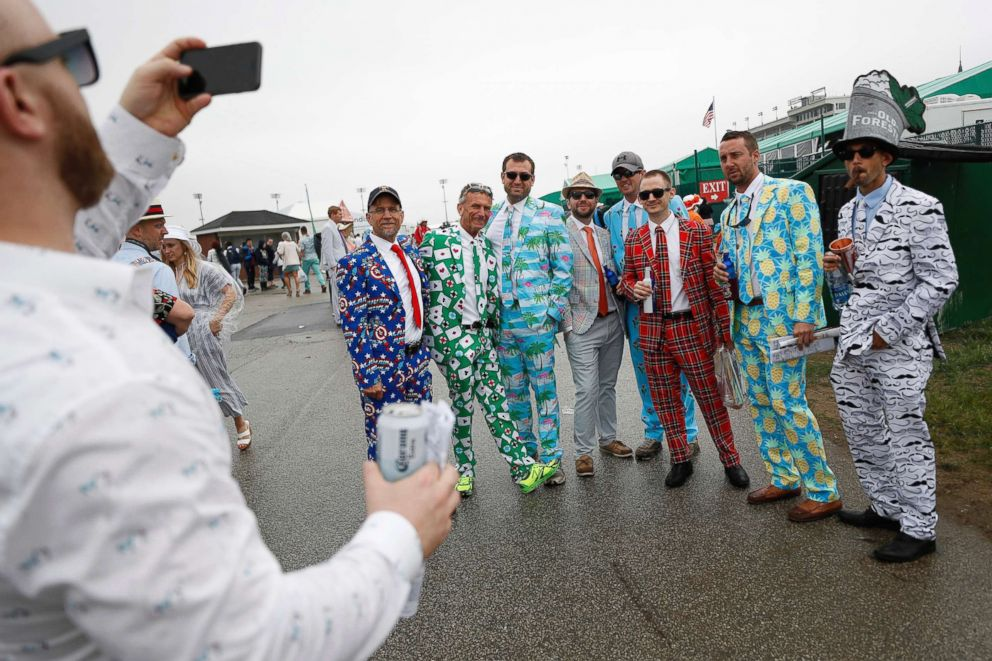 PHOTO: Men wear colorful suits in the infield before the 144th running of the Kentucky Derby horse race at Churchill Downs, May 5, 2018, in Louisville, Ky.