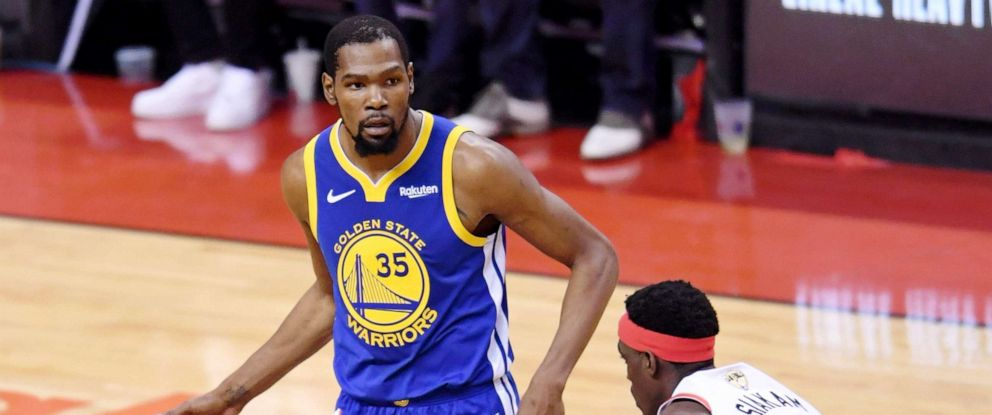 PHOTO: Golden State Warriors forward Kevin Durant (35) dribbles in front of Toronto Raptors forward Pascal Siakam (43) during the second quarter in game five of the 2019 NBA Finals at Scotiabank Arena, June 10, 2019, in Toronto.
