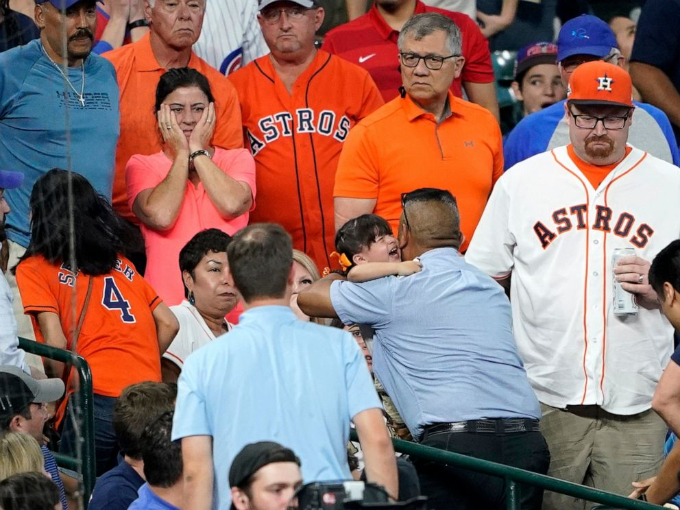 PHOTO: A young child is carried from the stands after being injured by a foul ball off the bat of Chicago Cubs Albert Almora Jr. during the fourth inning of a baseball game against the Houston Astros Wednesday, May 29, 2019, in Houston.