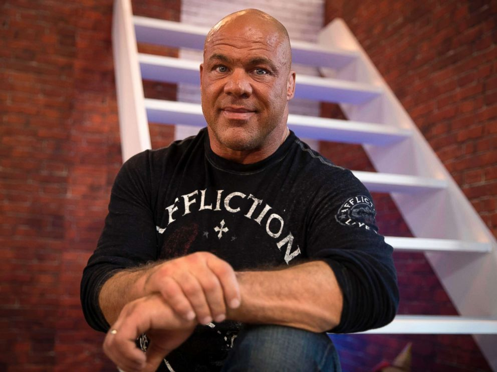 PHOTO: U.S. wrestler and actor Kurt Angle poses on November 4, 2017, as he attends the 2017 Paris Games Week, at the Porte de Versailles exhibition centre in Paris.