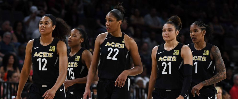 PHOTO: Nia Coffey #12, Lindsay Allen #15, Aja Wilson #22, Kayla McBride #21 and Tamera Young #1 of the Las Vegas Aces walk on the court on May 27, 2018 in Las Vegas.