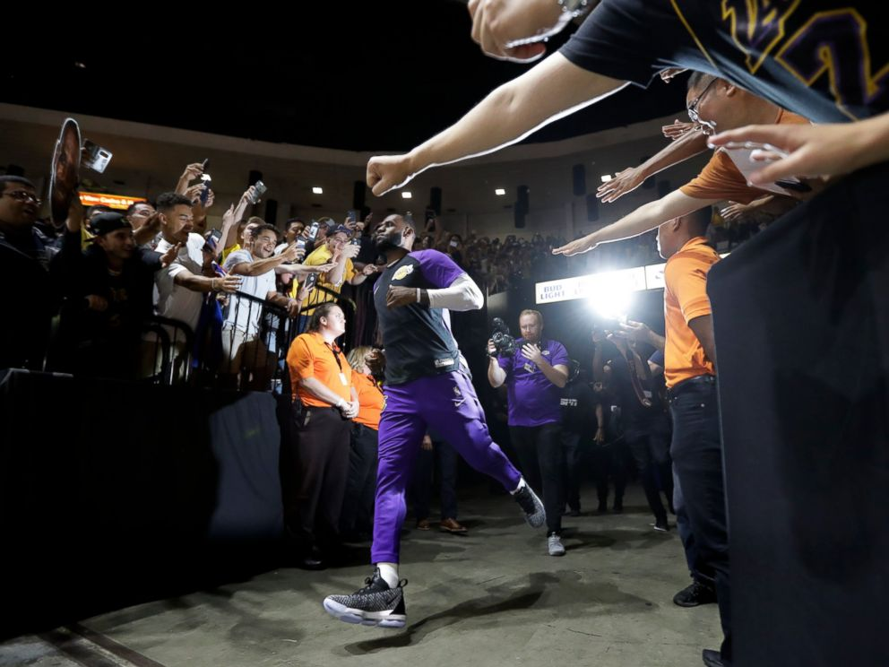 PHOTO: Los Angeles Lakers forward LeBron James runs past fans on his way to the court before an NBA preseason basketball game against the Denver Nuggets, Sunday, Sept. 30, 2018, in San Diego.