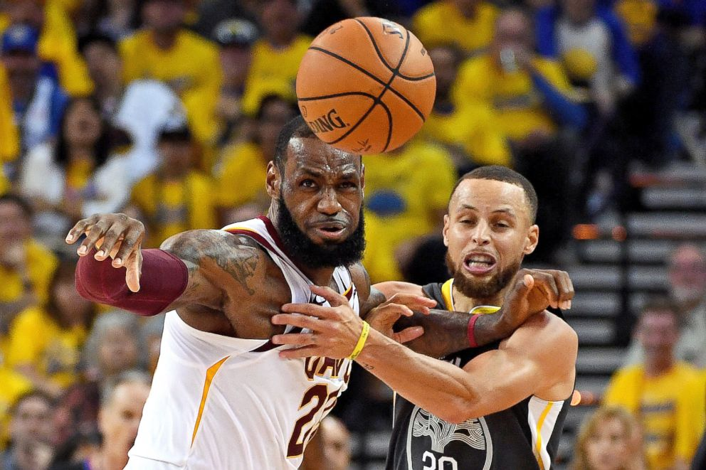 PHOTO: Golden State Warriors guard Stephen Curry (30) and Cleveland Cavaliers forward LeBron James (23) go for a loose ball during the second quarter in game one of the 2018 NBA Finals at Oracle Arena, June 3, 2018, Oakland, Calif.