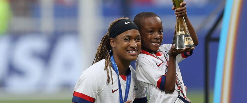 PHOTO: Jessica McDonald of the USA celebrates with her son following her teams victory in the 2019 FIFA Womens World Cup France Final match, July 7, 2019, in Lyon, France.