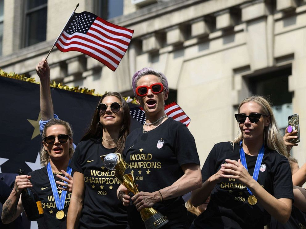 PHOTO: In this file photo taken on July 10, 2019, Megan Rapinoe, center, and other members of the World Cup-winning U.S. womens team take part in a ticker tape parade for the womens World Cup champions in New York.