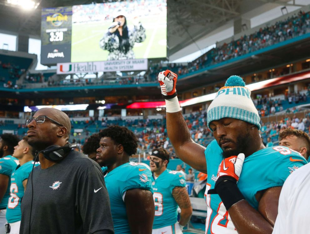 PHOTO: Miami Dolphins defensive end Robert Quinn raises his right fist during the singing of the national anthem, before the teams NFL preseason football game against the Tampa Bay Buccaneers, Aug. 9, 2018, in Miami Gardens, Fla.