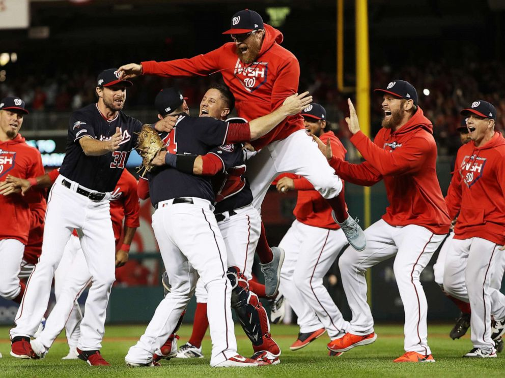 World Politics PHOTO: * The Washington Nationals celebrate winning game four of the National League Championship Series at Nationals Park on Oct. 15, 2019 in Washington, D.C.