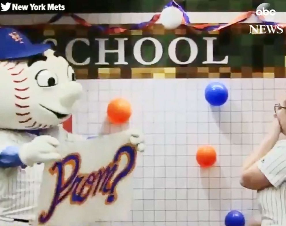 5e1cdf5b258a High school teen shocked by a  promposal  from favorite team s mascot