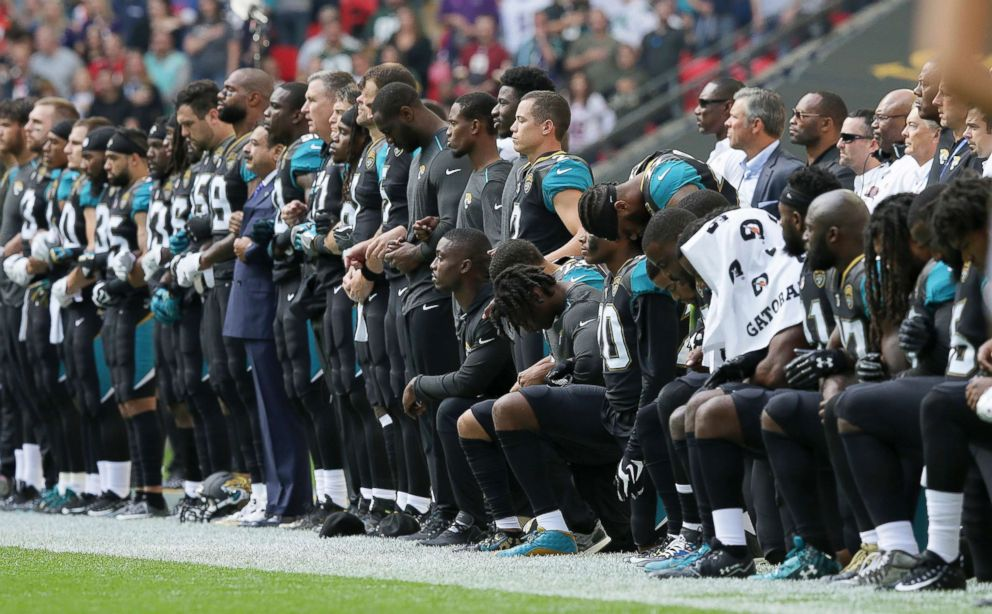 PHOTO: Jacksonville Jaguars NFL football players are shown, some standing and some kneeling, during the playing of the national anthem at Wembley Stadium in London, Sept. 24, 2017.