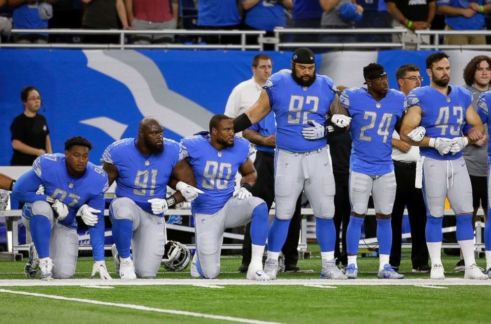 Detroit Lions defensive end Armonty Bryant, defensive tackle A'Shawn Robinson and defensive end Cornelius Washington take a knee during the national anthem before an NFL football game against the Atlanta Falcons, Sept. 24, 2017, in Detroit.