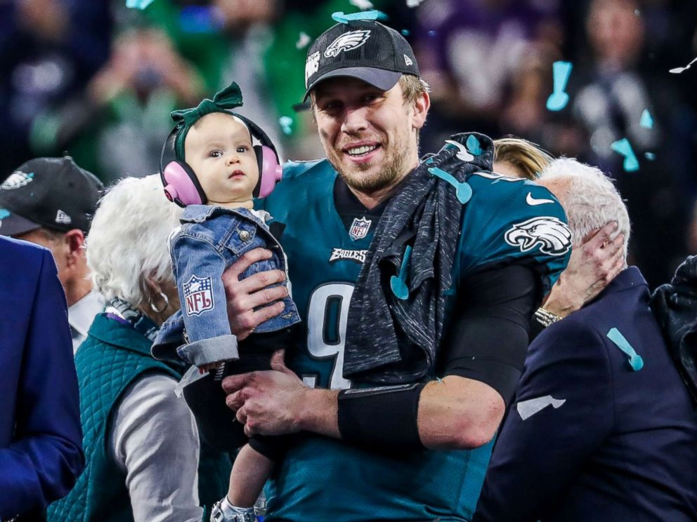 PHOTO: Philadelphia Eagles quarterback Nick Foles (#9) and his daughter Lily James Foles celebrate with the Vince Lombardi trophy after defeating the New England Patriots 41- 33 at Super Bowl LII at U.S. Bank Stadium in Minneapolis, Feb. 4, 2018.