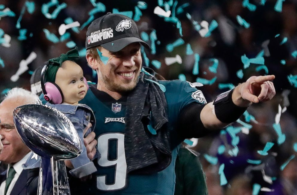 PHOTO: Philadelphia Eagles Nick Foles holds his daughter, Lily, after beating the New England Patriots in the NFL Super Bowl 52 football game, Feb. 4, 2018, in Minneapolis.