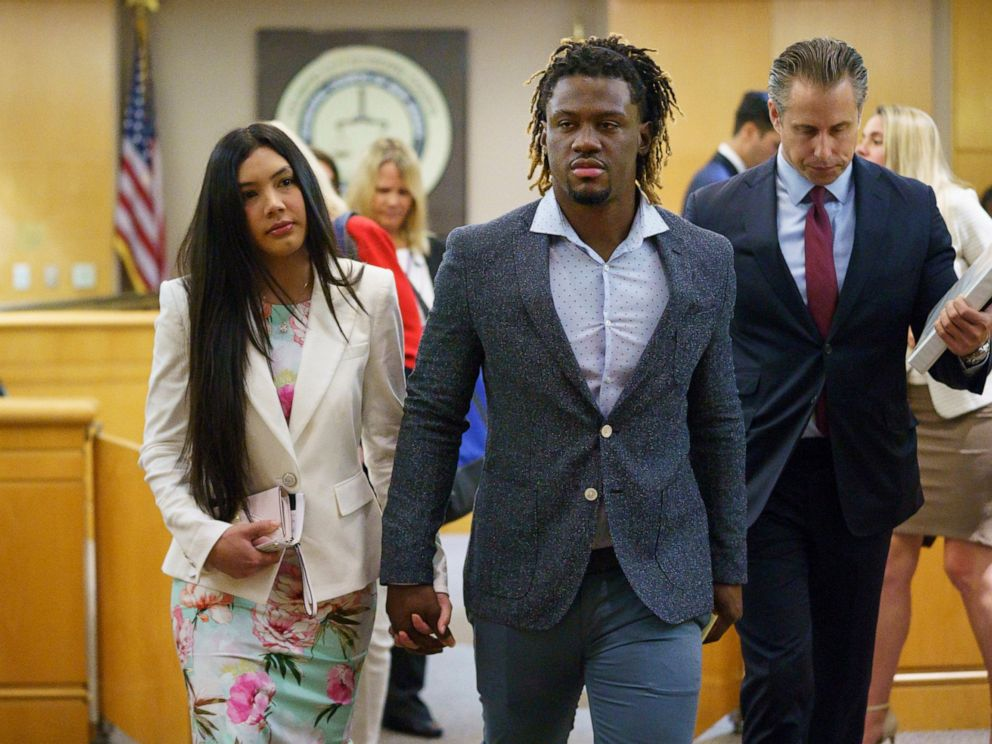 PHOTO: Philadelphia Phillies baseball player Odubel Herrera leaves a courtroom with an unidentified friend after a hearing on a domestic violence case in Atlantic City, N.J., Wednesday, July 3, 2019.