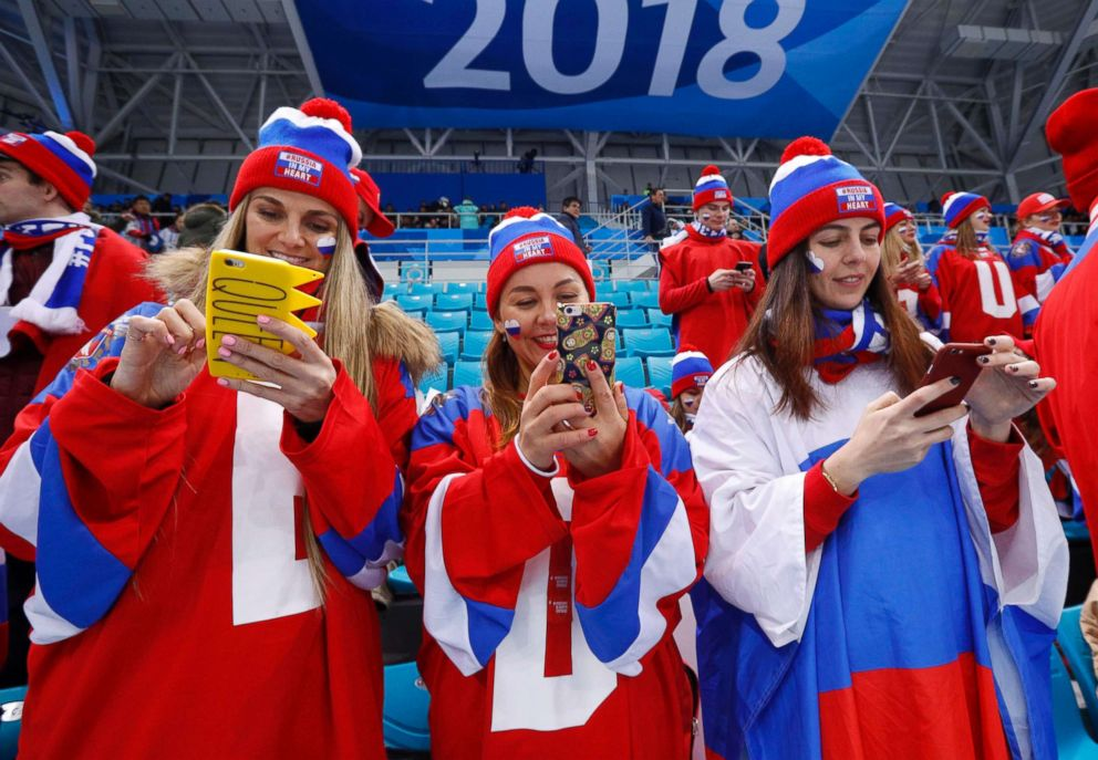 PHOTO: Russia fans check their phones before the Russia v Norway mens ice hockey quarterfinal game, Feb. 21, 2018, in Gangneung, South Korea.