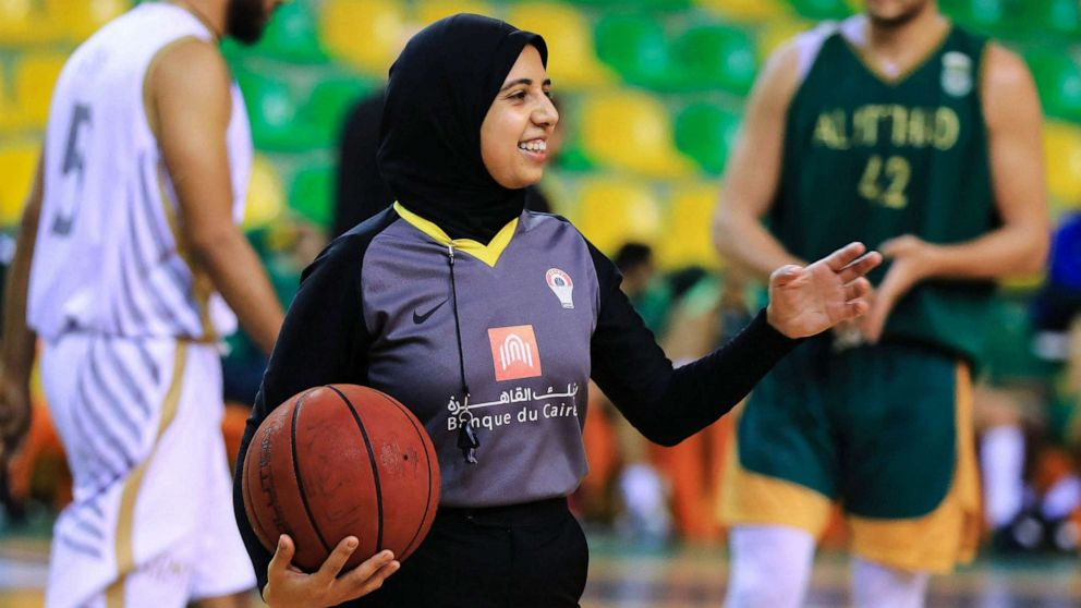 PHOTO: Egyptian Basketball referee Sarah Gamal gestures while holding a ball during a game in Alexandria, Egypt, April 17, 2021.