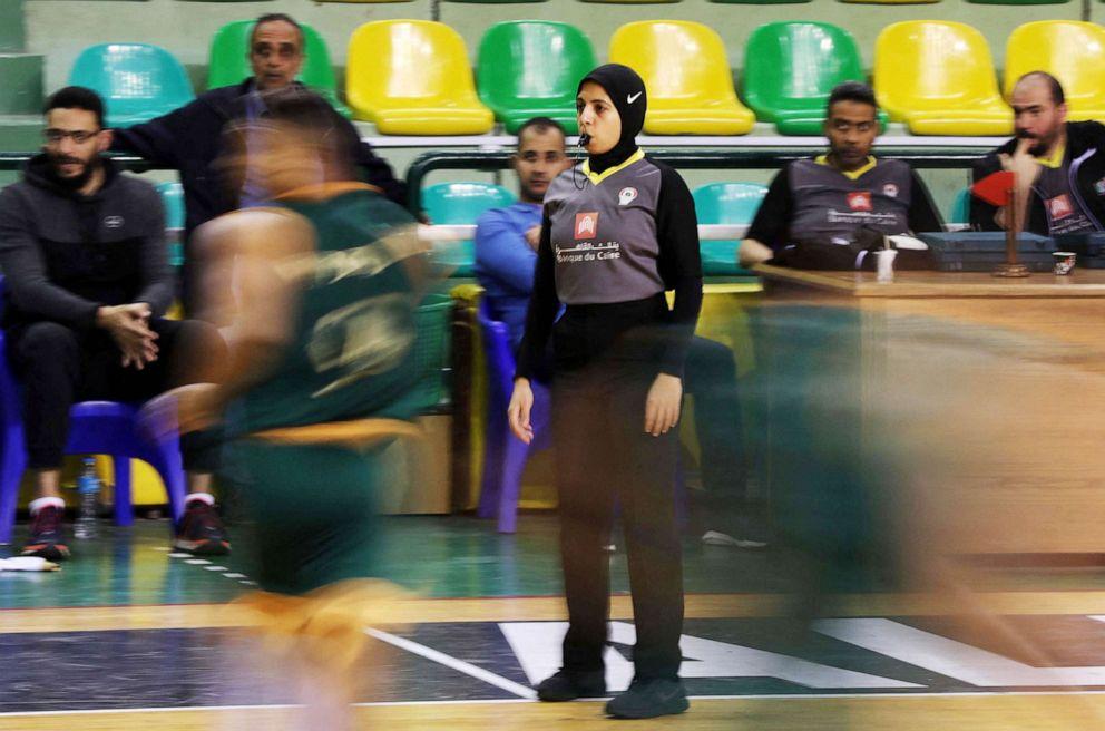 PHOTO: Egyptian Basketball referee Sarah Gamal looks on during a match between the Al-Ittihad and Al-Geish teams at the Al-Ittihad Al-Sakandari Arena in the country's northern city of Alexandria, April 17, 2021.