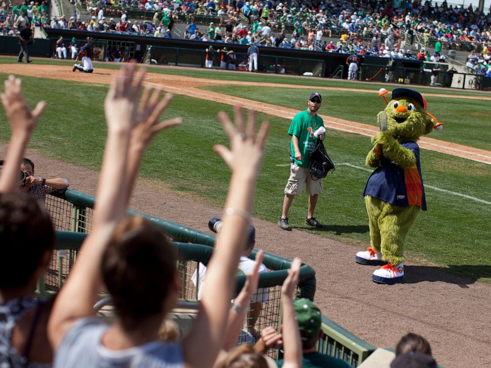 PHOTO: FILE - In this March 17, 2013, file photo, Orbit, the Houston Astros mascot, fires a T-shirt gun during the sixth inning of the teams spring training baseball game against the Toronto Blue Jays in Kissimmee, Fla.