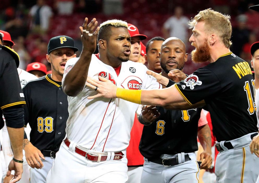 PHOTO: Yasiel Puig (No. 66) of the Cincinnati Reds is restrained during a bench clearing altercation against the Pittsburgh Pirates at Great American Ball Park on July 30, 2019 in Cincinnati.