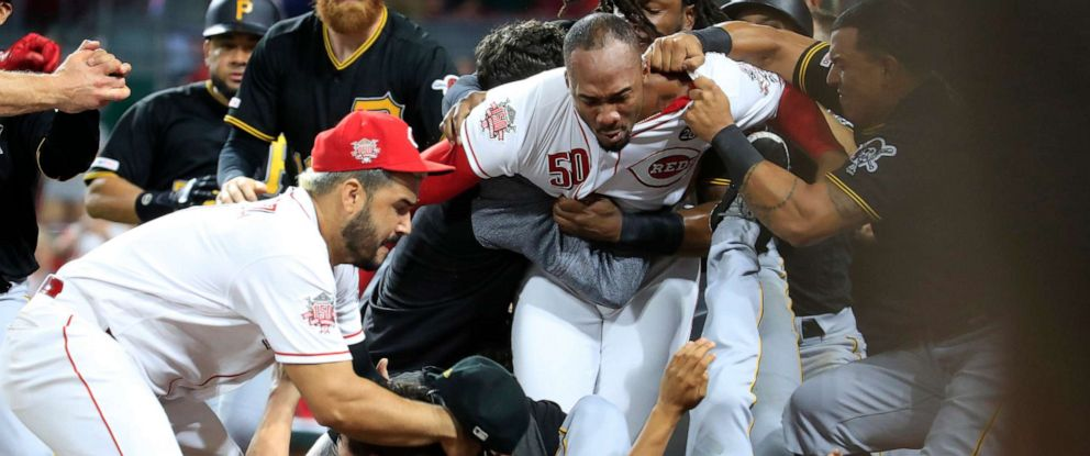 PHOTO: CINCINNATI, OHIO - JULY 30: Amir Garrett (No. 50, middle, white shirt) of the Cincinnati Reds engages members of the Pittsburgh Pirates during a bench clearing altercation July 30, 2019 in Cincinnati
